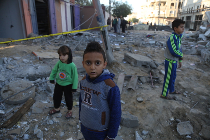 Palestinian children seen following the destruction of a building that housed Al Aqsa television station, following an Israeli air strike, November 13, 2018. (Mohammad Zaanoun/Activestills.org)