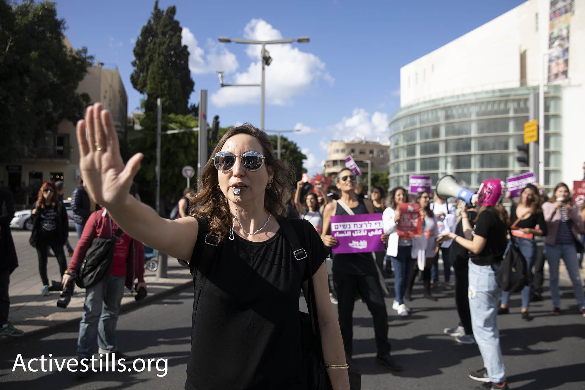 Demonstrators protesting violence against women in the streets of Tel Aviv on Dec. 4, 2018. (Oren Ziv/Activestills.org)