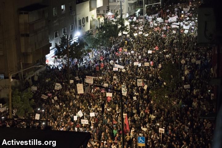 Over 20,000 asylum seekers and Israelis, including residents of south Tel Aviv, protest against Israel's plan to deport African asylum seekers, south Tel Aviv, February 25, 2018. (Oren Ziv/Activestills.org)