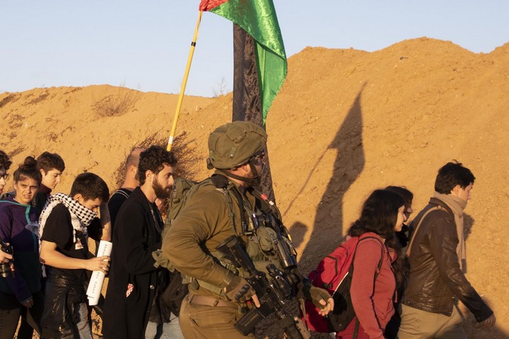 Right-wing mole 'Emanuel Brosh' seen marching behind an Israeli soldier alongside anti-occupation activists near the Gaza-Israel fence, December 21, 2018. (Oren Ziv/Activestills.org)