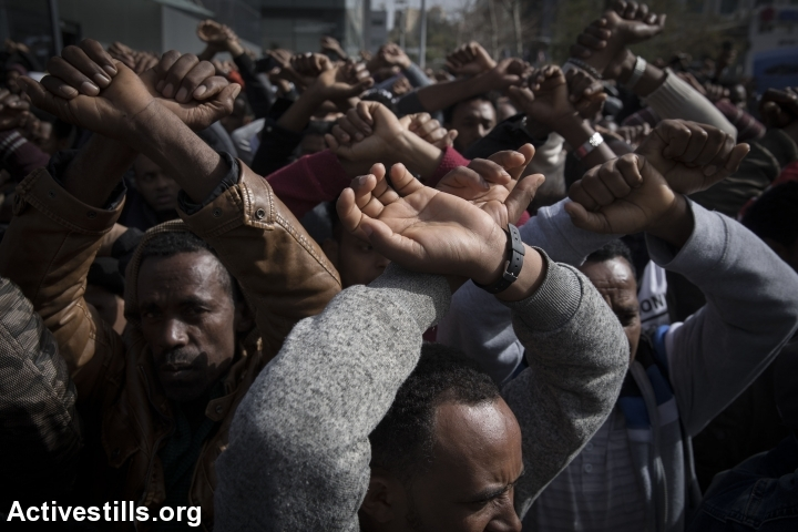 Asylum seekers from Sudan and Eritrea protest outside the embassy of Rwanda in Herzliya, near Tel Aviv, against the Israeli government's plan to deport African asylum seekers to a third-party countries in Africa, presumed to be Rwanda and Uganda, January 22, 2018. (Oren Ziv/Activestills.org)