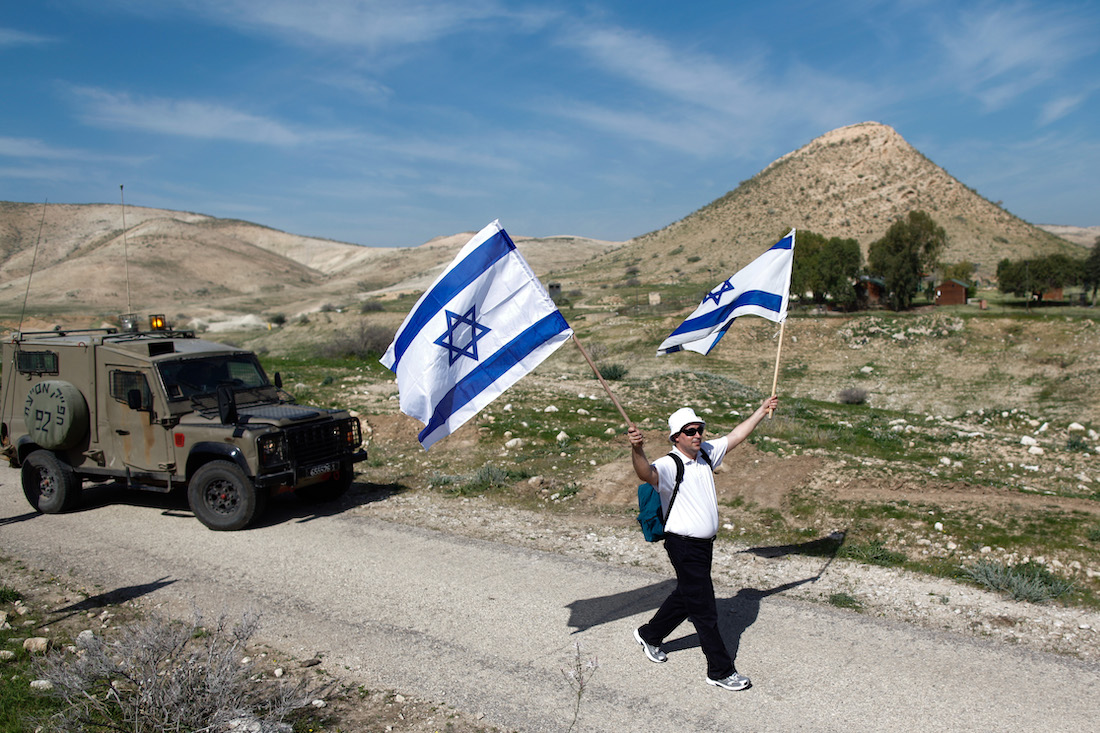An Israeli man takes part in an annual nationalist march through the Jordan Valley in the occupied West Bank, February 21, 2014. (Yonatan Sindel/Flash90)