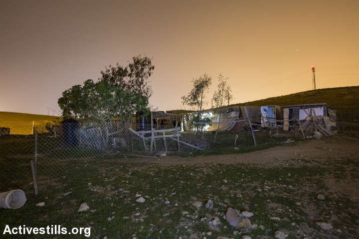 A structure used to house a family in the Palestinian Bedouin community of Khan al-Ahmar, West Bank, February 23, 2017. (Faiz Abu Rmeleh/Activestills.org)