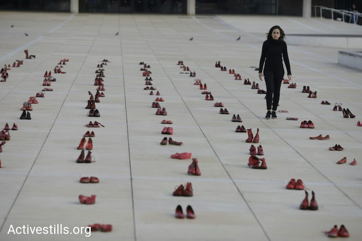Feminist activists paint hundreds of pairs of shoes red to protest gender violence, Tel Aviv, December 4, 2018. (Oren Ziv/Activestills.org)