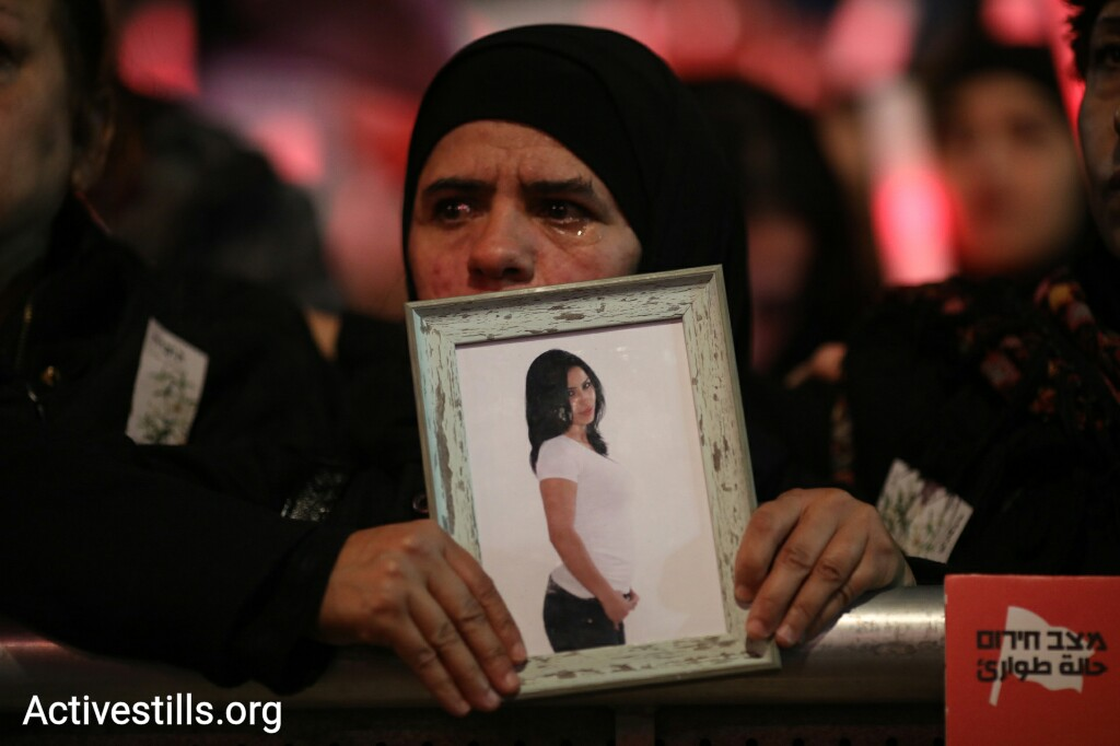 A Palestinian protester takes part in a mass rally against government inaction toward gender violence, Rabin Square, Tel Aviv, December 4, 2018. (Oren Ziv/Activestills.org)