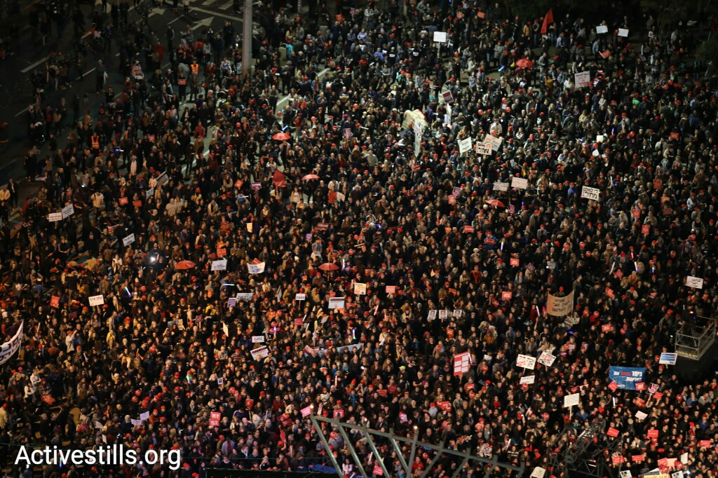 Tens of thousands take part takes part in a mass rally against government inaction toward gender violence, Rabin Square, Tel Aviv, December 4, 2018. (Oren Ziv/Activestills.org)