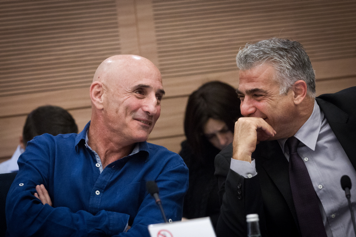 Yesh Atid head Yair Lapid speaks with MK Ofer Shelah at a Foreign Affairs and Security Committee meeting in the Knesset, November 19, 2015. (Miriam Alster/Flash90)