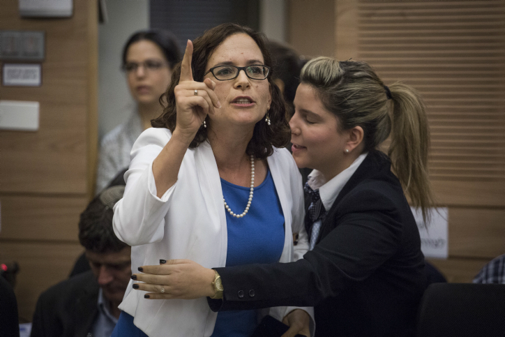 Knesset Member Rachel Azaria is taken out at the Finance Committee meeting discussing sports and gambling budgets at the Knesset, on November 30, 2016. (Hadas Parush/Flash90)