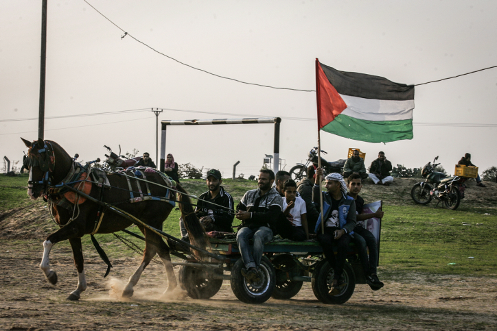 Palestinians participate in the Great Return March near the Gaza-Israel fence, east of Rafah in the southern Gaza Strip, November 30, 2018. (Abdel Rahim Khatib/Flash90)