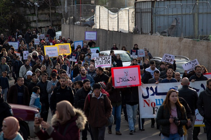 Israeli, international, and Palestinian activists march in the East Jerusalem neighborhood of Sheikh Jarrah against an expected new wave of demolitions, January 19, 2019. (Activestills.org)