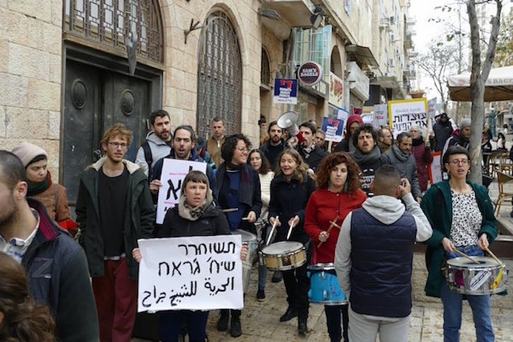 Hundreds of activists marched from West Jerusalem to the East Jerusalem neighborhood of Sheikh Jarrah to stop the eviction of Palestinian families there, on January 18, 2018. (Photo courtesy of A. Daniel Roth)