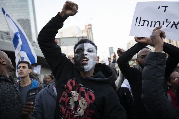 Thousands of Ethiopian Israelis and their supporters marched against police violence in Tel Aviv on Jan. 30, 2018, weeks following the fatal police shooting of Yehuda Biadga. (Oren Ziv/Activestills.org)