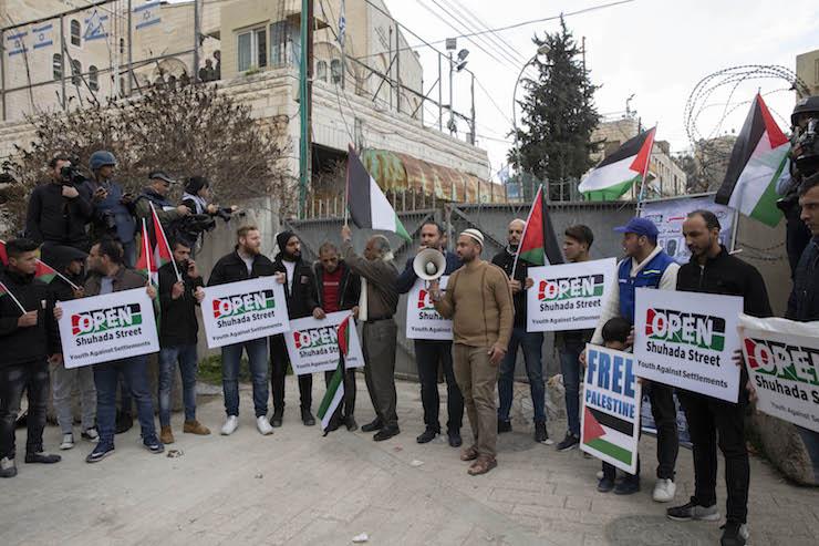 Palestinian activist Issa Amro speaking at the protest against segregation and settlements in Hebron's Shuhada Street on Feb. 22, 2019. (Oren Ziv/Activestills.org)