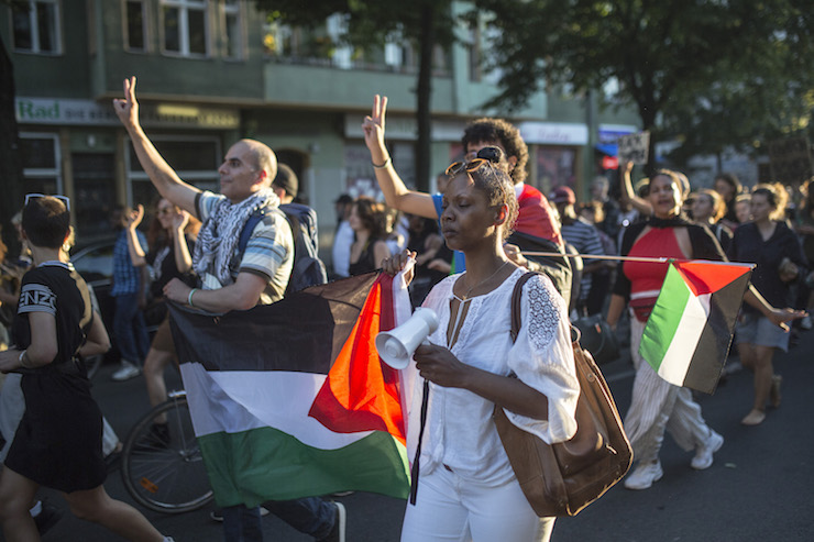 <p>Protesters carry Palestinian flags during a Black Lives Matter protest march, Berlin, Germany, June 29, 2018. (Activestills.org)