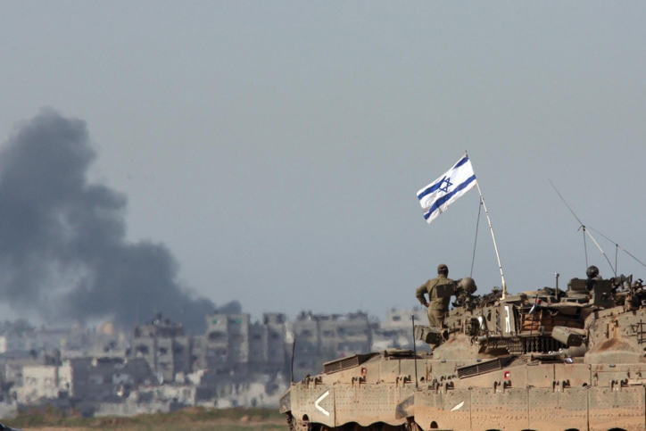 Israeli tanks standing on the Israel-Gaza border while smoke billows from Gaza during Operation Cast Lead, January 14, 2009. (Yossi Zamir/Flash90)