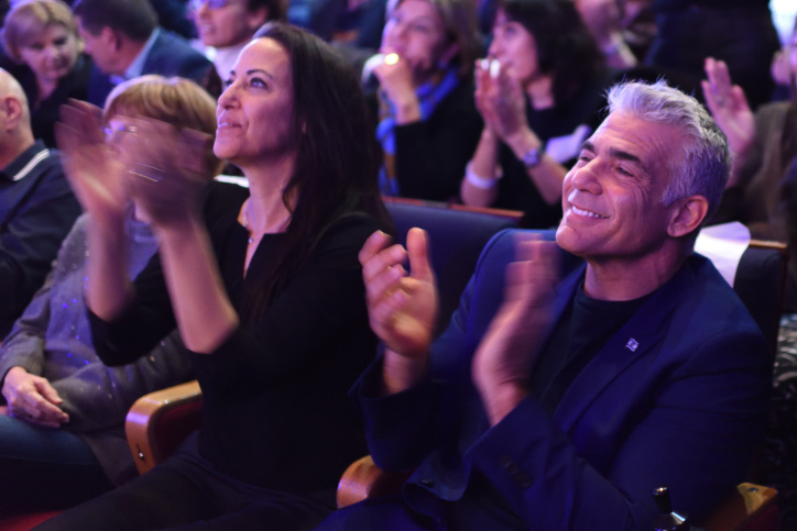 Yair Lapid, seen alongside his wife Lihi Lapid, during an event marking the opening of his party's election campaign, Rishon Lezion, January 8, 2019. (Gili Yaari/Flash90)