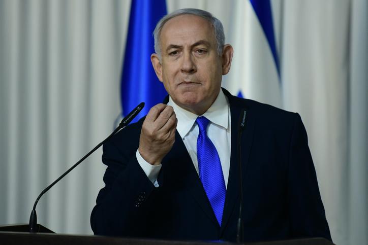 Prime Minister Benjamin Netanyahu delivers a statement to the media in Kfar Maccabiah, Ramat Gan on February 21, 2019. (Tomer Neuberg/Flash90)