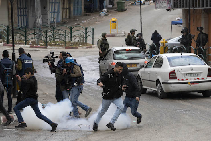 Israeli soldiers fired stun grenades at a group of journalists covering the protest for the re-opening of Hebron's Shuhada Street on Feb. 22, 2019. (Oren Ziv/Activestills.org)