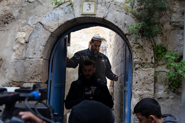 An Israeli settler surveys the Abu Saab family home, after police evict the family, Jerusalem's Old City, February 17, 2019. (Activestills.org)