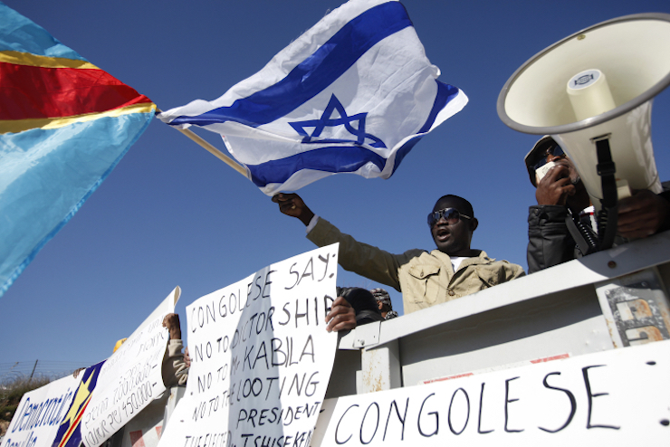 Congelese activists demonstrate outside Prime Minister Netanyahu's office, demanding the Israeli government disregard the re-election of Congolese President Joseph Kabila and support opposition leader Etienne Tshisekedi, December 18, 2011. (Miriam Alster/Flash90)