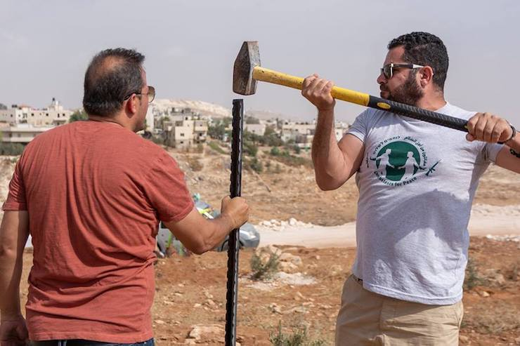 Palestinian peace activist Osama Iliwat (left) seen in the village of Jeb al-Deeb, south of Bethlehem in the West Bank. (Courtesy of Combatants for Peace)