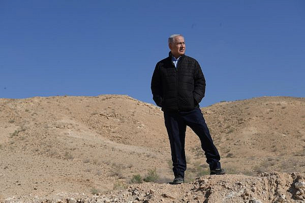 Israeli Prime Minister Benjamin Netanyahu in a government handout photo, taken near Israel's southern order with Egypt, March 7, 2019. (Amos Ben-Gershom/GPO/Handout)