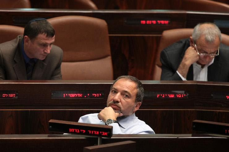 Israeli politician Avigdor Lieberman looks on as he sits in the plenum of the Knesset in Jerusalem on April 6, 2009. (Kobi Gideon/Flash90)