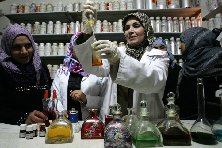 Palestinian women working in a small laboratory manufacturing perfumes at the Rafah refugee camp in the southern Gaza Strip on January 8, 2012. (Abed Rahim Khatib/Flash90)