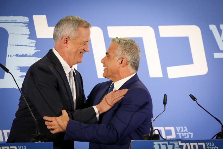 Benny Gantz and Yair Lapid of the Blue and White party give a joint statement in Tel Aviv on February 21, 2019. (Noam Revkin Fenton/Flash90)