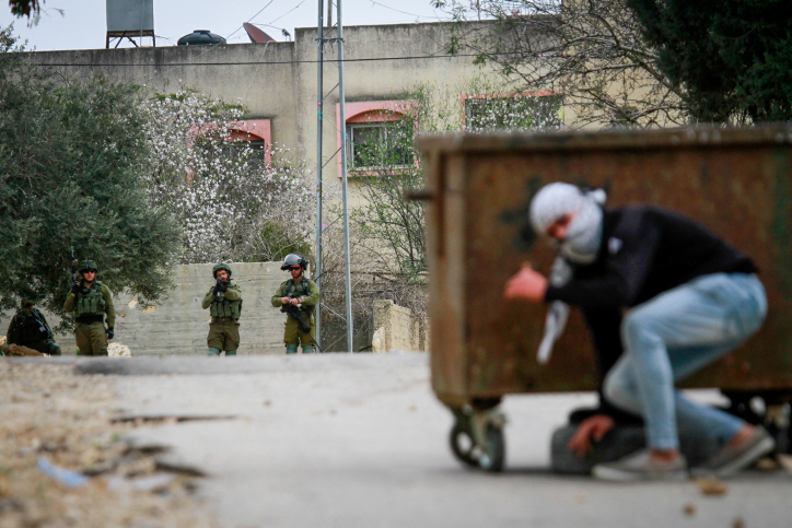 Israeli soldiers clash with Palestinian protesters in the village of Kfar Qaddum, near the West Bank city of Nablus, February 1, 2019. (Nasser Ishtayeh/Flash90)