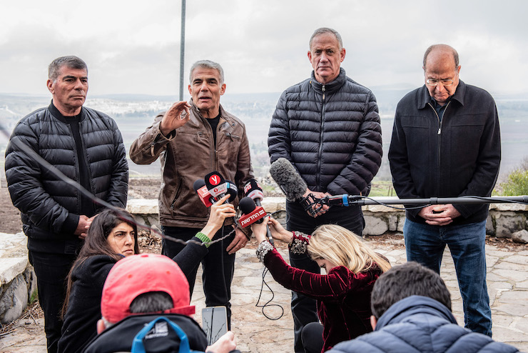 (Left to Right) Gabi Ashkenazi, Yair Lapid, Benny Gantz, and Moshe Ya'alon of the 'Blue and White' party speak with the press in the Golan Heights, March 4, 2019. (Basel Awidat/Flash90)