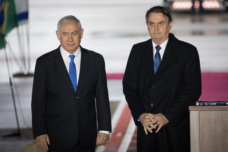Brazilian president Jair Bolsonaro with Israeli Prime Minister Benjamin Netanyahu, during his welcome ceremony at Ben Gurion Airport near Tel Aviv on March 31, 2019. (Noam Revkin Fenton/Flash90)