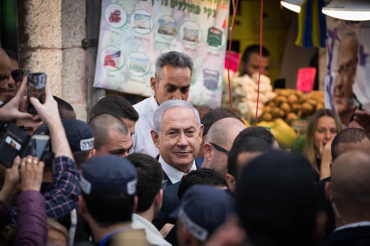 Israeli Prime Minister Benjamin Netanyahu seen during an election campaign tour in the Mahane Yehuda market in Jerusalem on April 8, 2019. (Yonatan Sindel/Flash90)