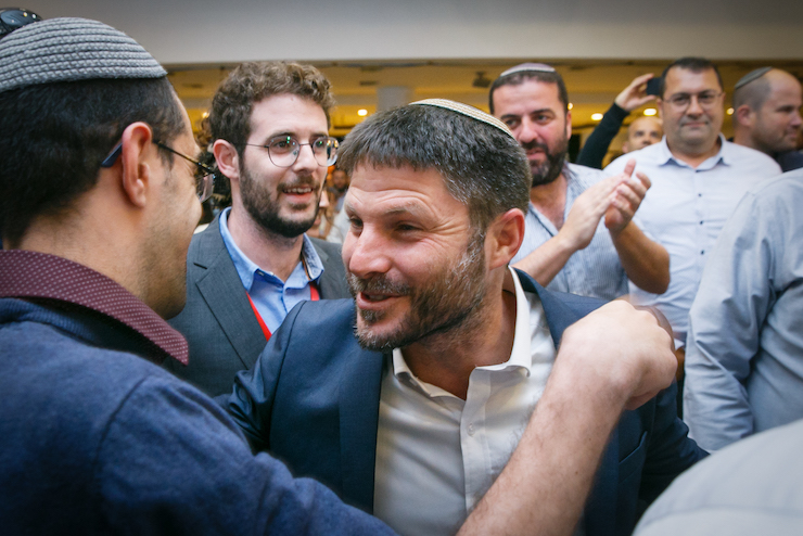 Bezalel Smotrich speaks to supporters of the United Right, a union of right wing parties, at the party headquarters on April 09, 2019. (Flash90)