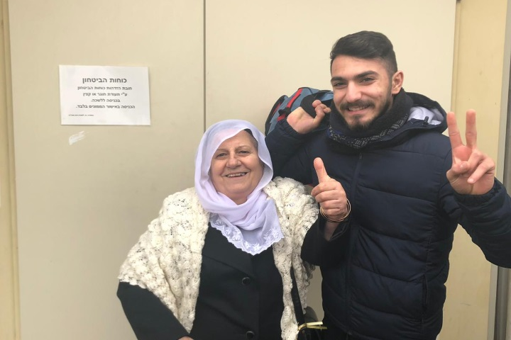 Kamal Zidan and his grandmother pose for a photo before he presented himself at the Israeli army induction base. (Courtesy of the Zidan family)