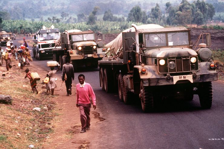 A convoy of American military vehicles brings fresh water from Goma in Congo to Rwandan refugees in Kimbumba refugee camp, Zaire, in August 1994.
