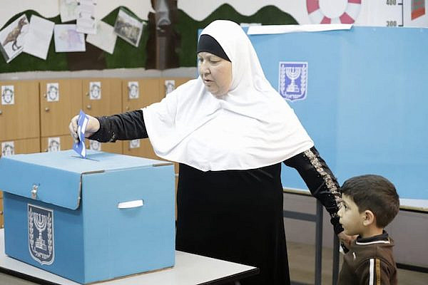 A Palestinian citizen of Israel casts her vote in the 2019 election, Taybeh, central Israel, April 9, 2019. (Oren Ziv/Activestills.org)