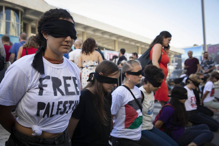 Israeli and international activists hold a solidarity protest with Palestinian prisoners outside the Eurovision Song Contest opening ceremony in central Tel Aviv, May 12, 2019. (Oren Ziv/Activestills.org)