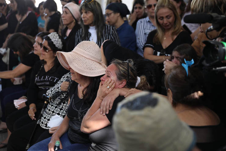 Mourners seen at the funeral of Moshe Agadi, who was killed by a rocket fired from Gaza that struck his home in Ashdod, southern Israel, May 5, 2019. (Oren Ziv/Activestills.org)