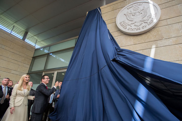 Steven Munchin, U.S. Secretary of the Treasury, and daughter of President Donald Trump, Ivanka Trump, reveal a dedication plaque at the official opening ceremony of the U.S. embassy in Jerusalem on May 14, 2018. (Yonatan Sindel/Flash90)