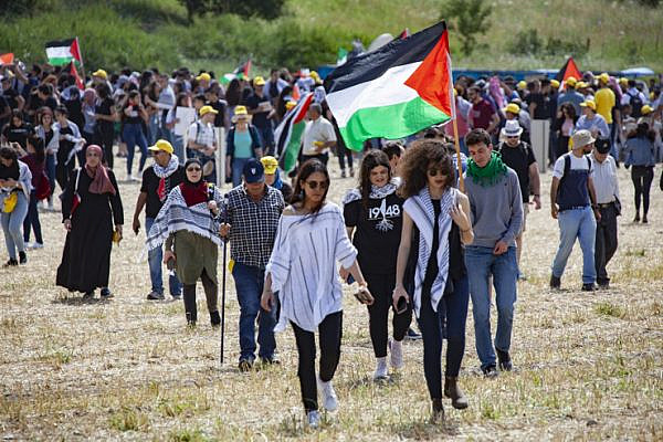Palestinian citizens of Israel take part in the Return March, held at the destroyed village of Khubbeiza, to mark Nakba Day, May 9, 2019. (Mati Milstein)