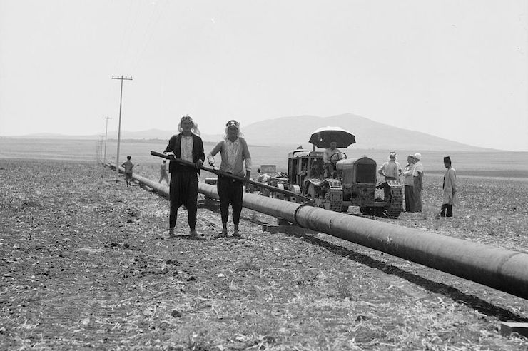 IPC assistants welding pipes together on the Esdraelon stretch of the Jezreel Valley in Palestine in the 1930s. (American Colony Photographic Department)