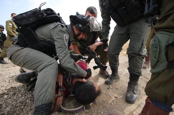 The Israeli army arrestedPalestinian, Israeli and international activists who were repairing an access road in the South Hebron Hills on May 3, 2019. (Ahmad al-Bazz/Activestills.org)