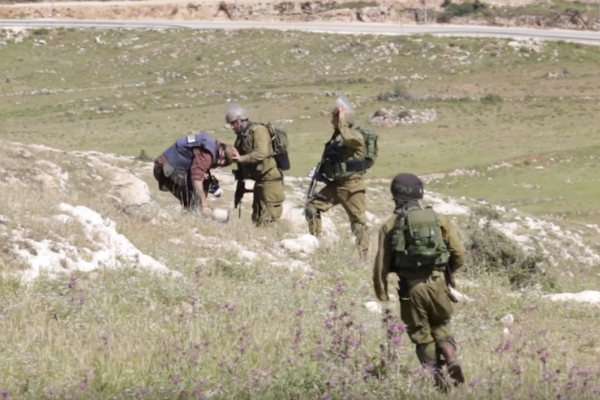 Israeli soldiers seen attacking and throwing stones at photographers in the Palestinian village of Nabi Saleh, April 24, 2015.