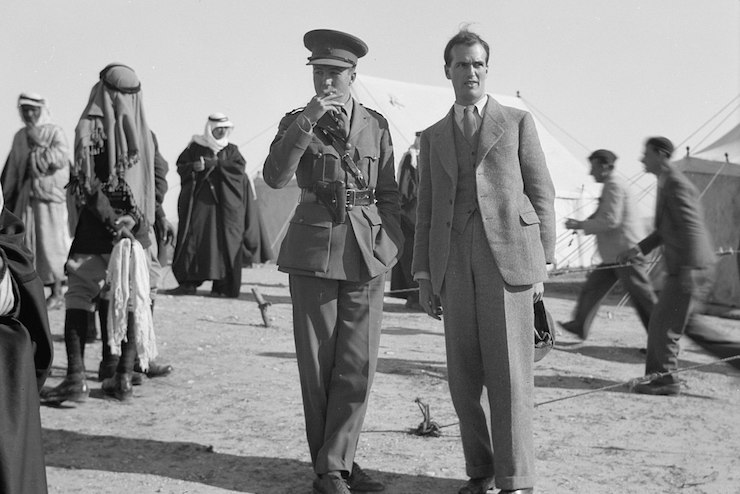 British diplomat John Holmes seen alongside a military officer during a tribal lunch at a cavalry post in Tel al-Meleiha, 20 miles north of Be'er Sheba, January 18, 1940. (Library of Congress)