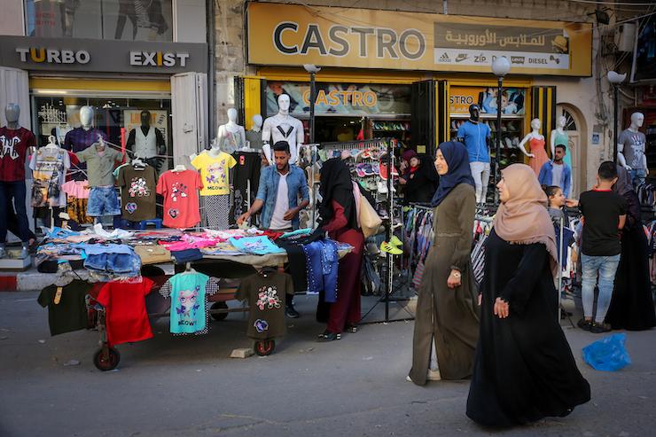 Palestinian women walk through a relatively empty market in Khan Younis in the Gaza Strip, May 6, 2019. (Abed Rahim Khatib/Flash90)