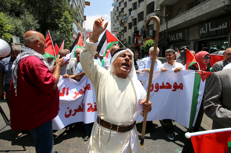 "Palestinians in Ramallah protesting the U.S.-led economic workshop to be held in Bahrain, as part of the Trump administration's ""Deal of the Century"" plan for ending the conflict, June 15, 2019. (Ahmad Al-Bazz/Activestills.org)"