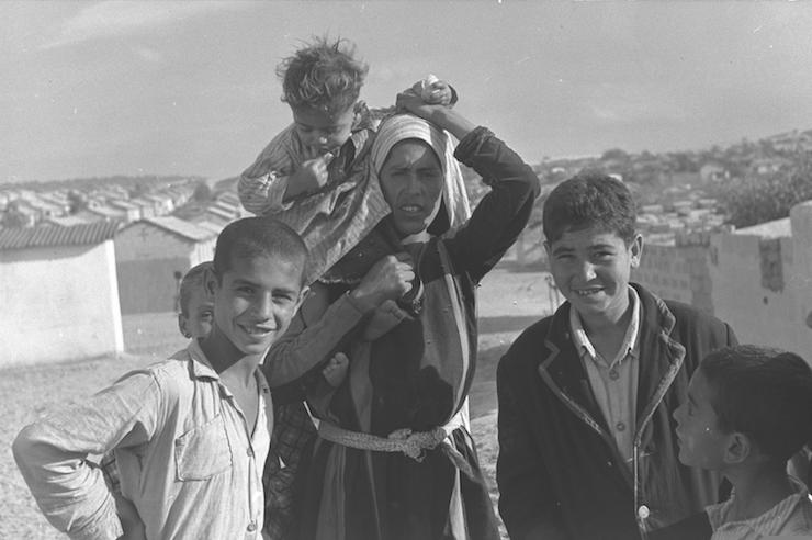 A Palestinian refugee family seen in a Gaza refugee camp, January 11, 1956. (Moshe Pridan/GPO)