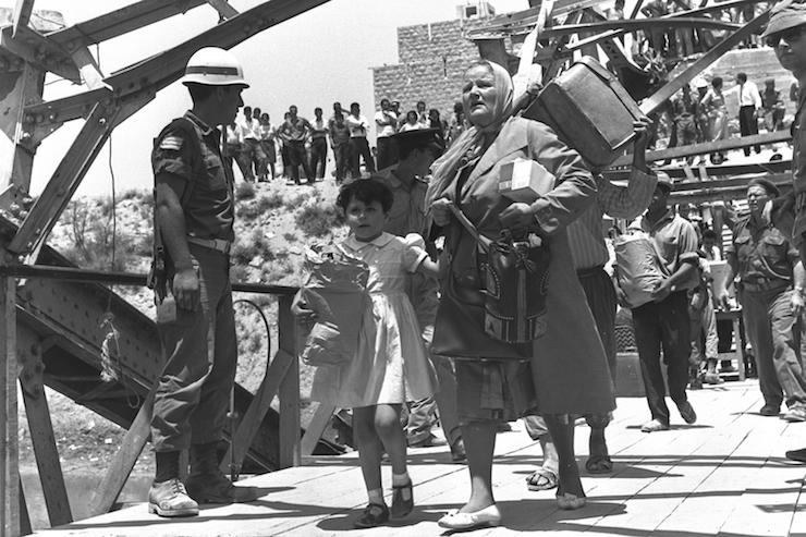 Palestinian families who fled to Jordan during the Six-Day War return to the West Bank through Allenby Bridge under an Israeli agreement with the Red Cross, July 18, 2019. (Teddy Brauner/GPO)