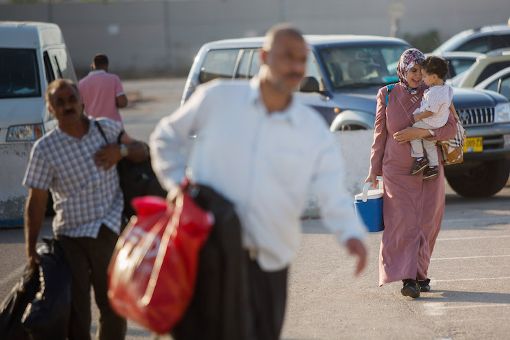 Palestinians arrive at the Erez Crossing between Israel and Gaza on September 3, 2015. (Yonatan Sindel/Flash90)